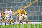 Anthony Maher Duagh drives at the Dromid defenders led by Colm Ó Concubhair during their Junior C'ship final in Fitzgerald Stadium on Sunday
