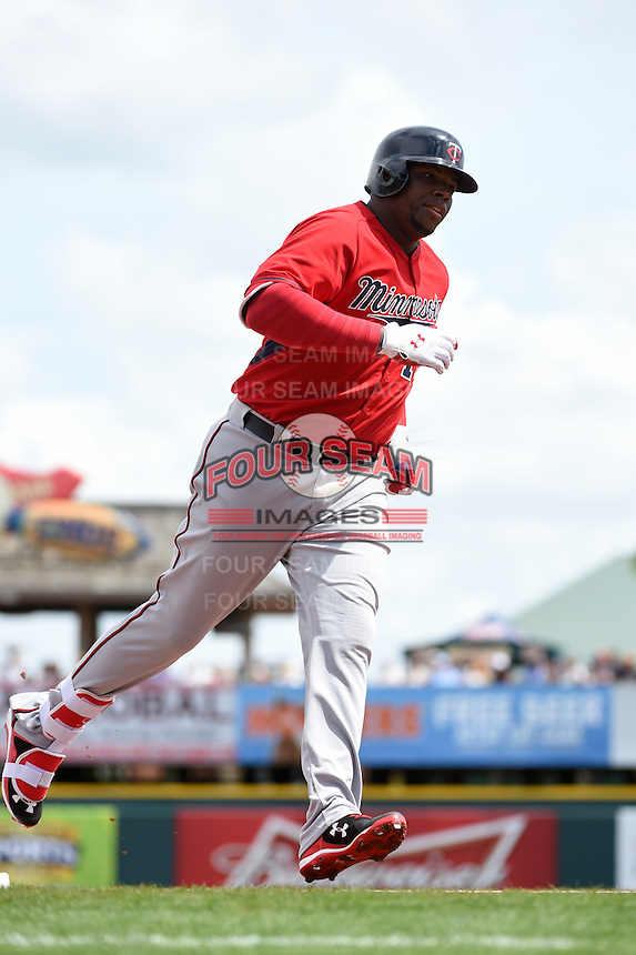 Minnesota Twins first baseman Kennys Vargas (19) runs the bases after hitting a home run during a Spring Training game against the Pittsburgh Pirates on March 13, 2015 at McKechnie Field in Bradenton, Florida.  Minnesota defeated Pittsburgh 8-3.  (Mike Janes/Four Seam Images)