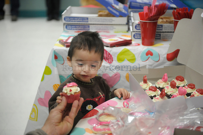 Brandon Orantez, 2, gets a cupcake during the Dream Factory Valentine's Party at Kentucky Children's Hospital in Lexington, Ky., on 2/14/12. Photo by Mike Weaver | Staff