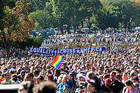 Tens of thousands of protesters gathered at the Capitol Building as part of the National Equality March, Sunday, Oct. 11, 2009. The march wound through downtown Washington, DC and the National Mall before culminating at the Capitol Building lawn. Dozens of LGBT rights activists such as NAACP President Julian Bond, singer Lady Gaga, and activist Cleeve Jones called for full legal equality across the country, marking the 30th anniversary of the first such march, led by Harvey Milk in 1979. (Joseph Shemuel/pressphotointl.com)