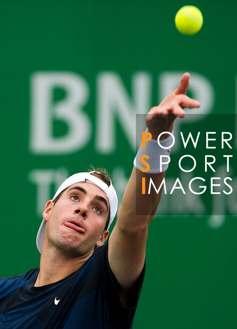 SHANGHAI, CHINA - OCTOBER 12:  John Isner of USA serves to Lukasz Kubot of Poalnd during day two of the 2010 Shanghai Rolex Masters at the Shanghai Qi Zhong Tennis Center on October 12, 2010 in Shanghai, China.  (Photo by Victor Fraile/The Power of Sport Images) *** Local Caption *** John Isner