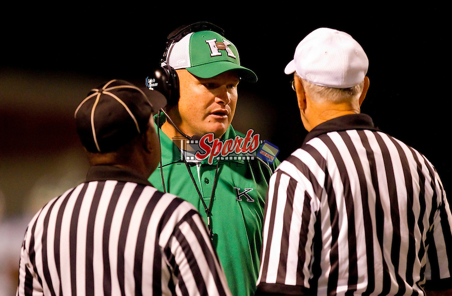 A.L. Brown Wonders head coach Mike Newsome talks with two officials prior to the start of the second half against the South Rowan Raiders at South Rowan High School August 26, 2011, in China Grove, North Carolina.  The Wonders defeated the Raiders 63-12.  (Brian Westerholt/Sports On Film)