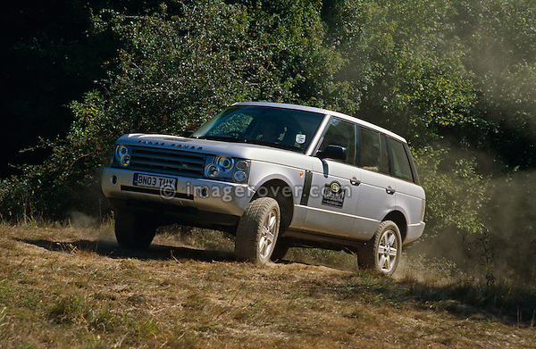New silver Range Rover 3rd generation demonstrator off roading at the Dunsfold Collection of Landrovers Open Day 2003. Dunsfold, Surrey, UK, Europe 2003. NO RELEASES AVAILABLE. Automotive trademarks are the property of the trademark holder, authorization may be needed for some uses.