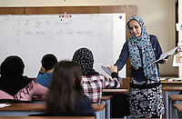 Pictured: A teacher hands over papers Monday 06 February 2017<br />