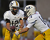 Massapequa quarterback No. 12 Brad Baldinger, left, hands off to No. 14 Chris Bacotti during a Nassau County Conference I varsity football game against host Freeport High School on Friday, September 25, 2015<br /> <br /> James Escher