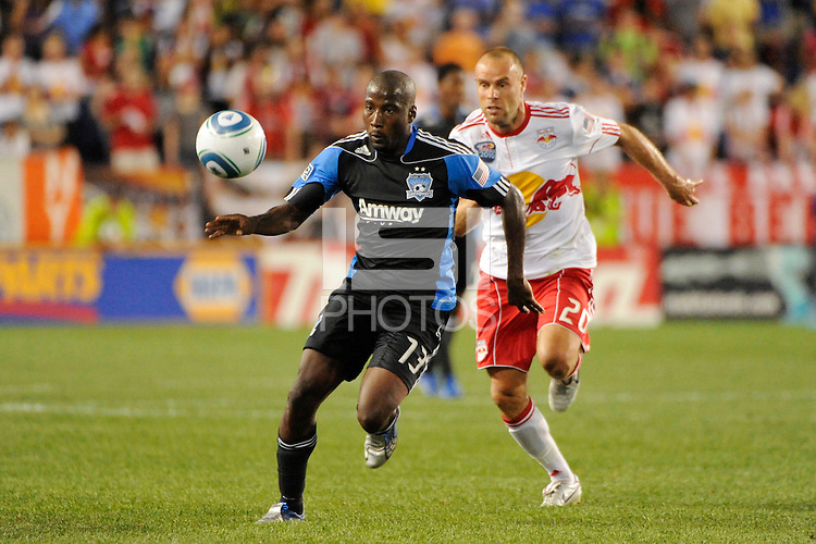 Cornell Glen (13) of the San Jose Earthquakes is chased by Joel Lindpere (20) of the New York Red Bulls. The New York Red Bulls defeated the San Jose Earthquakes 2-0 during a Major League Soccer (MLS) match at Red Bull Arena in Harrison, NJ, on August 28, 2010.