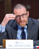 """Thomas Rid, Professor, Department of War Studies, King's College, London, makes his opening statement as he testifies before the US Senate Select Committee on Intelligence conducting an open hearing titled """"Disinformation: A Primer in Russian Active Measures and Influence Campaigns"""" on Capitol Hill in Washington, DC on Thursday, March 30, 2017. Photo Credit: Ron Sachs/CNP/AdMedia"""