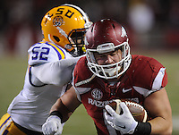 NWA Media/ANDY SHUPE - Arkansas' AJ Derby, right, is pushed out of bounds by LSU's Kendell Beckwith (52) during the fourth quarter Saturday, Nov. 15, 2014, at Razorback Stadium in Fayetteville.