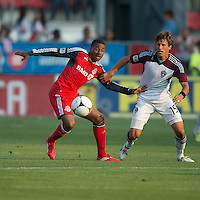 18 July 2012: Colorado Rapids midfielder Wells Thompson #15 and Toronto FC midfielder Reggie Lambe #19 in action during an MLS game between the Colorado Rapids and Toronto FC at BMO Field in Toronto, Ontario..Toronto FC won 2-1..