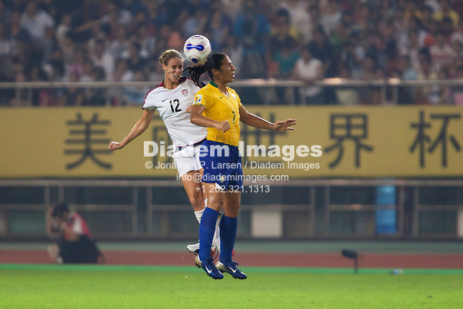 HANGZHOU, CHINA - SEPTEMBER 27:  Leslie Osborne of the United States (L) and Daniela of Brazil (R) clash for a header during the FIFA Women's World Cup semifinal match at Hangzhou Dragon Stadium on September 27, 2007 in Hangzhou, China.  Editorial use only.  Commercial use prohibited.  No pushing to mobile device usage.  (Photograph by Jonathan Paul Larsen)