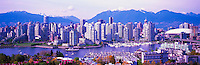 "City of Vancouver Skyline and Downtown at Yaletown and ""False Creek"", British Columbia, Canada, in Spring.  The North Shore Mountains (Coast Mountains) rise above the City. - Panoramic View (Historical Roof on BC Place)"