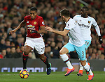 Luis Antonio Valencia of Manchester United tussles with Aaron Cresswell of West Ham United during the Premier League match at the Old Trafford Stadium, Manchester. Picture date: November 27th, 2016. Pic Simon Bellis/Sportimage
