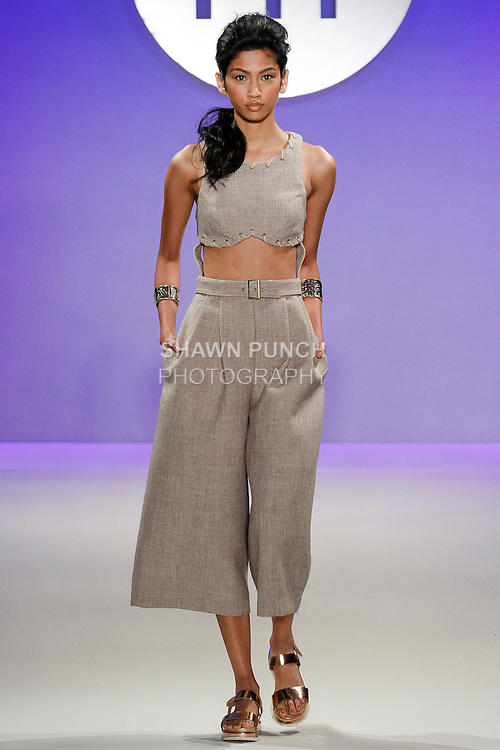 Model walks runway in an outfit by Marina Ross, during the FIT Future of Fashion 2014 Graduates' Collection fashion show, at the Fashion Institute of Technology on May 1, 2014.