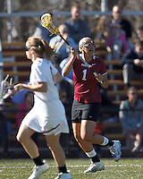 Harvard University midfielder Chelsey Newman (1) looks to pass.