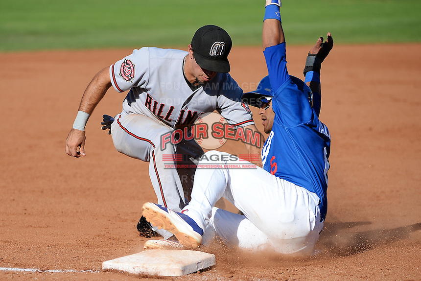Taylor Terrasas (5) of the Billings Mustangs makes the tag on a sliding Jesmuel Valentin (6) of the Ogden Raptors at Lindquist Field on August 18, 2013 in Ogden Utah.  (Stephen Smith/Four Seam Images)