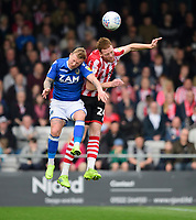 Lincoln City's Cian Bolger vies for possession with Macclesfield Town's Elliott Durrell<br /> <br /> Photographer Chris Vaughan/CameraSport<br /> <br /> The EFL Sky Bet League Two - Lincoln City v Macclesfield Town - Saturday 30th March 2019 - Sincil Bank - Lincoln<br /> <br /> World Copyright © 2019 CameraSport. All rights reserved. 43 Linden Ave. Countesthorpe. Leicester. England. LE8 5PG - Tel: +44 (0) 116 277 4147 - admin@camerasport.com - www.camerasport.com