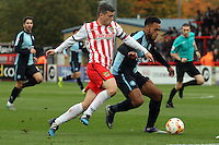 Steven Schumacher of Stevenage and Aaron Holloway of Wycombe Wanderers in action during the Sky Bet League 2 match between Stevenage and Wycombe Wanderers at the Lamex Stadium, Stevenage, England on 17 October 2015. Photo by PRiME Media Images.