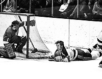 Seals vs RedWings:Seals Tommy Williams with RedWings goalie Roy Edwards  (1971 photo/Ron Riesterer)