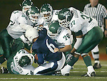 Edmonds-Woodway Warriors defenders Micah Lester (54), Dayne Richards (55), Jon Keeten (81), John Wilczynski(76)) and Josh Heard (37) gang tackle Meadowdale Mavericks' quarterback Matt Johnson in the first half at Edmonds Stadium on Friday, Sept. 1, 2006. Jim Bryant Photo