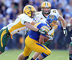 BROOKINGS, SD - SEPTEMBER 28:  Trevor Tiefenthaler #84 from South Dakota State University is brought down by Christian Dudzik #35 from North Dakota State University in the first quarter of their game Saturday afternoon at Coughlin Alumni Stadium in Brookings. (Photo by Dave Eggen/Inertia)