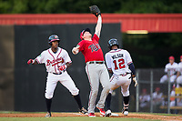 Elizabethton Twins first baseman Kolton Kendrick (23) catches a pop fly off the bat of Isranel Wilson (12) of the Danville Braves as Jeremy Fernandez (8) looks on at American Legion Post 325 Field on July 1, 2017 in Danville, Virginia.  The Twins defeated the Braves 7-4.  (Brian Westerholt/Four Seam Images)