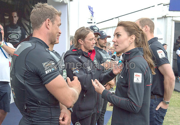 24 July 2016 - Princess Kate Duchess of Cambridge and Prince William Duke of Cambridge chatting to the British Team at the America's Cup World Series Race in Portsmouth. The royal couple visited the home of the British competitors for the America's Cup before observing the ongoing competition. Photo Credit: ALPR/AdMedia