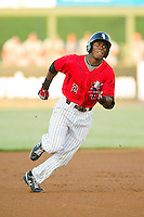 Tim Anderson (2) of the Kannapolis Intimidators hustles towards third base against the Rome Braves at CMC-Northeast Stadium on August 24, 2013 in Kannapolis, North Carolina.  The Intimidators defeated the Braves 6-1.  (Brian Westerholt/Four Seam Images)