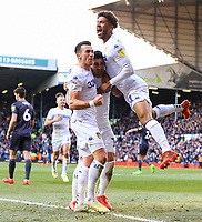 Leeds United's Jack Harrison celebrates scoring the opening goal with Pablo Hernandez and Tyler Roberts<br /> <br /> Photographer Alex Dodd/CameraSport<br /> <br /> The EFL Sky Bet Championship - Leeds United v Sheffield Wednesday - Saturday 13th April 2019 - Elland Road - Leeds<br /> <br /> World Copyright © 2019 CameraSport. All rights reserved. 43 Linden Ave. Countesthorpe. Leicester. England. LE8 5PG - Tel: +44 (0) 116 277 4147 - admin@camerasport.com - www.camerasport.com