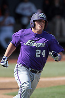 Josh Elander #24 of the TCU Horned Frogs runs to first base against the Cal State Fullerton Titans at Goodwin Field on February 26, 2012 in Fullerton,California. Fullerton defeated TCU 11-10.(Larry Goren/Four Seam Images)