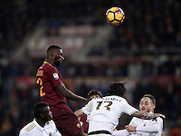 Calcio, Serie A: Roma vs Milan. Roma, stadio Olimpico, 12 dicembre 2016.<br /> Roma's Antonio Ruediger, left, and Milan's Alessio Romagnoli jump for the ball during the Italian Serie A football match between Roma and AC Milan at Rome's Olympic stadium, 12 December 2016.<br /> UPDATE IMAGES PRESS/Isabella Bonotto