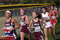 Villa Duchesne's trio of Elise Marker (right), Hannah Deines (left), and Cece Stock (center), lead their team to victory in the Class 3 District 2 race.