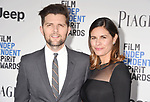 SANTA MONICA, CA - FEBRUARY 25: Actor Adam Scott (L) and Naomi Scott attend the 2017 Film Independent Spirit Awards at the Santa Monica Pier on February 25, 2017 in Santa Monica, California.
