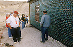 Tourists at The Bottle House, built in 1905 by 76 year-old Tom Kelly from 30,000 bottles in Rholite, Nev.