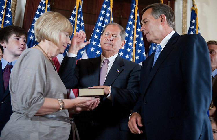 UNITED STATES - SEPTEMBER 15:  Speaker John Boehner, R-Ohio, right, conducts a swear in ceremony on the House side of the Capitol with Rep. Bob Turner, R-N.Y., and his wife Peggy, after Turner was sworn in on the house floor.  (Photo By Tom Williams/Roll Call)