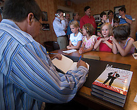 Former Congressman and Fox News host John Kasich signs copies of his new book, &quot;Stand for Something&quot;, in the Westerville Public Library reproduction of his Washington office. The library opened Sunday, June 11, 2006, the offices containing Kasich's historical records and personal library from his years as a U.S. congressman.<br />