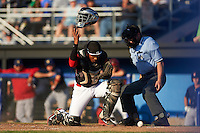 Batavia Muckdogs catcher Pablo Garcia (7) and umpire John Budka look for a pitch in the dirt during a game against the State College Spikes on June 24, 2016 at Dwyer Stadium in Batavia, New York.  State College defeated Batavia 10-3.  (Mike Janes/Four Seam Images)