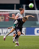 Sonia Bompastor (8) of the Washington Freedom goes up for a header against Kendall Fletcher (4) of the Saint Louis Athletica at RFK Stadium in Washington, DC.  The Washington Freedom defeated Saint Louis Athletica, 3-1.