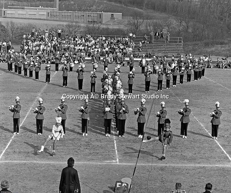 Bethel Park PA:  View of the Bethel Park High School Band and Majorettes performing during half-time of the Bethel Park Blackhawks vs the Elisabeth Forward Warrior football game - 1963