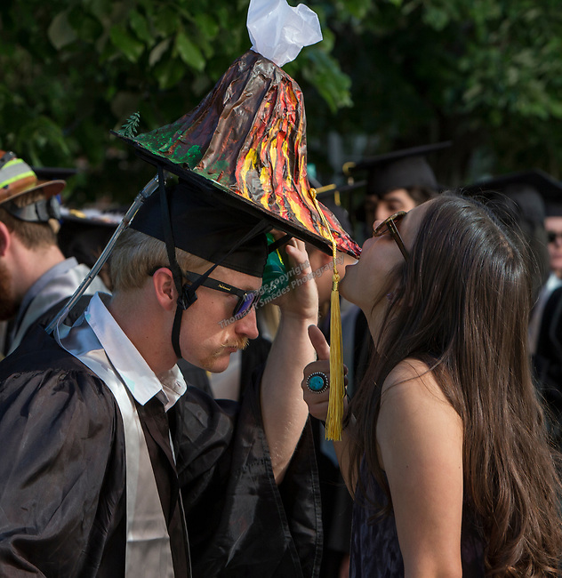 Brittany Media drinks water off of Dayton Adams volcano graduation cap during the University of Nevada College of Engineering, College of Science and Orvis School of Nursing graduation ceremony on Thursday evening, May 18, 2017.