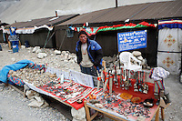 "China started building a controversial 67-mile ""paved highway fenced with undulating guardrails"" to Mount Qomolangma, known in the west as Mount Everest, to help facilitate next year's Olympic Games torch relay./// A tent owner stands in front his tent guest house selling souvenirs at the tent village near Everest base camp.<br /> Tibet, China<br /> July, 2007"