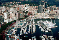 Aerial view of Port of Monaco surrounded by high-rise buildings. Luxury yachts in port on the Mediterranean Sea. Monte Carlo, Monaco