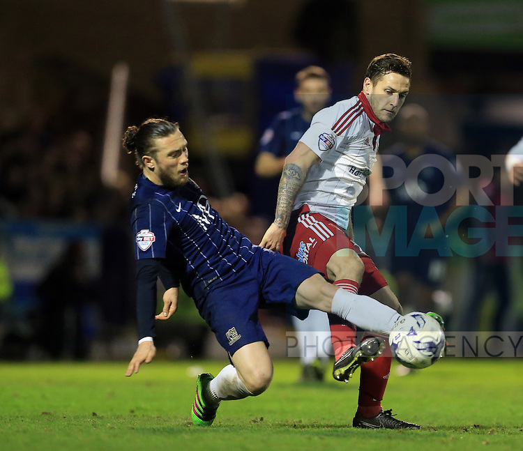 Southend's Ben Coker tussles with Sheffield United's Billy Sharp during the League One match at Roots Hall Stadium.  Photo credit should read: David Klein/Sportimage
