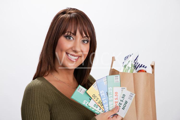 USA, Illinois, Metamora, Portrait of woman holding shopping bag and coupons