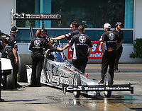 Mar 20, 2016; Gainesville, FL, USA; Crew members with NHRA top fuel driver Dave Connolly during the Gatornationals at Auto Plus Raceway at Gainesville. Mandatory Credit: Mark J. Rebilas-USA TODAY Sports