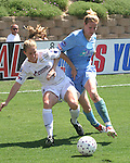 Carrie Moore (left) and Cindy Parlow (right) fight for the ball at Torero Stadium in San Diego, CA on 8/24/03 during the WUSA's Founders Cup III between the Atlanta Beat and Washington Freedom. The Freedom won 2-1 in overtime.