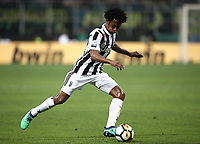 Calcio, Serie A: Inter - Juventus, Milano, stadio Giuseppe Meazza (San Siro), 28 aprile 2018.<br /> Juventus' Juan Cuadrado in action during the Italian Serie A football match between Inter Milan and Juventus at Giuseppe Meazza (San Siro) stadium, April 28, 2018.<br /> UPDATE IMAGES PRESS/Isabella Bonotto