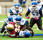 WATERBURY,  CT-101219JS21- Sacred Heart-Kaynor's (33) gets brought down by Crosby's Stephen Diggs (23), Michail Scott (16), Isaiah Miller (52) and (57) during their game Saturday at Municipal Stadium in Waterbury.<br /> Jim Shannon Republican-American