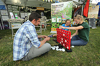 Pictured L-R: Rhodri Jones of Blaenau Gwent Council with Elise Leadbeater and Candice Laroche Saturday 13 August 2016<br />Re: Grow Wild event at  Furnace to Flowers site in Ebbw Vale, Wales, UK