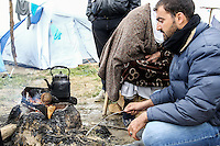 Pictured: Migrants light a fire to cook food at the camp Monday 07 March 2016<br /> Re: Refugees at the Greek FYRO Macedonian border in Idomeni, Greece.