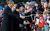 United States President Barack Obama (L) greets school children with President Hu Jintao of China during a State arrival ceremony on the South Lawn of the White House, Wednesday, January 19, 2011 in Washington, DC. Obama and Hu are scheduled to meet in the Oval Office later in the day, hold a joint press conference and attend a State dinner. .Credit: Mark Wilson / Pool via CNP